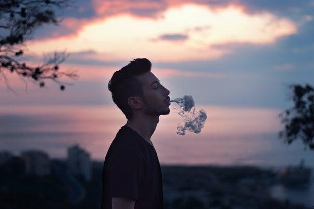 Man exhaling Co2 oil vape